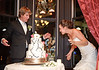 Playing with some cake at The Adelman Building. By Mike Reid, Boise wedding photographer.