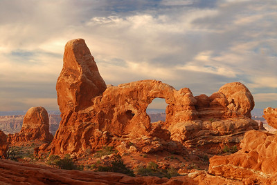 First rays of dawn on Turret Arch. Arches National Park in Utah. Photo by Mike Reid, All Outdoor Photography.