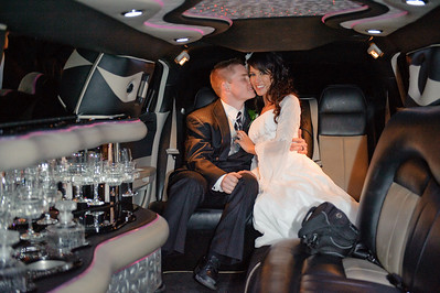In the Limo. Just married couples portrait. By Mike Reid, Boise Wedding Photographer.