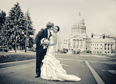 Bride and groom, just married, in front of the Boise Capital Bldg. Photo by Mike Reid, Boise wedding photographer.